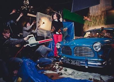 blue car being filmed in studio
